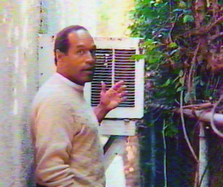 ". O.J. Simpson is seen in the area behind the guest house where Kato Kaelin lived and near the area where former Los Angeles Police Detective Mark Fuhrman reported finding a bloody glove on Simpson\'s Brentwood estate after the murders of Nicole Brown Simpson and Ron Goldman. Simpson taped his own home video after his acquittal to resurrect his image and provide his views on the events in the case. ""Hard Copy\""  will broadcast the tape during several episodes starting Wednesday, Jan. 10, 1996. (AP Photo/Hard Copy)"
