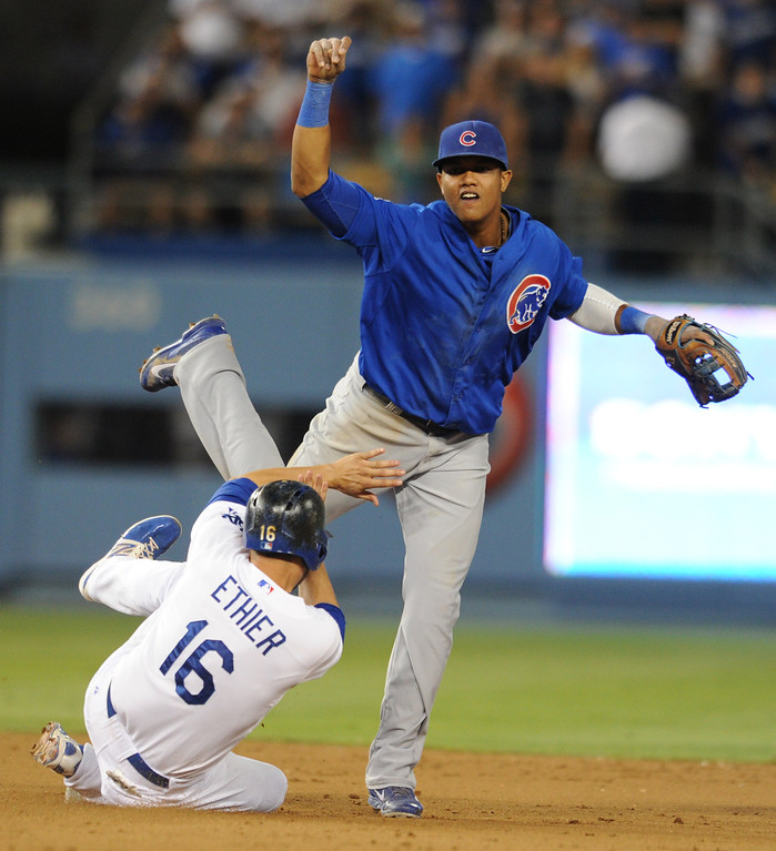 . Andre Either collides with Starlin Castor as he gets caught in a double play in the 8th inning. The Cubs defeated the Dodgers 3-2 in a game at Dodger Stadium. Los Angeles, CA. 8/24/2013(John McCoy/LA Daily News)