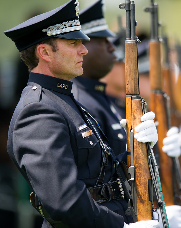 . Honor guard stand with rifles at the burial of LAPD officer Chris Cortijo, Tuesday, April 22, 2014, at Forest Lawn Hollywood Hills. (Photo by Michael Owen Baker/L.A. Daily News)
