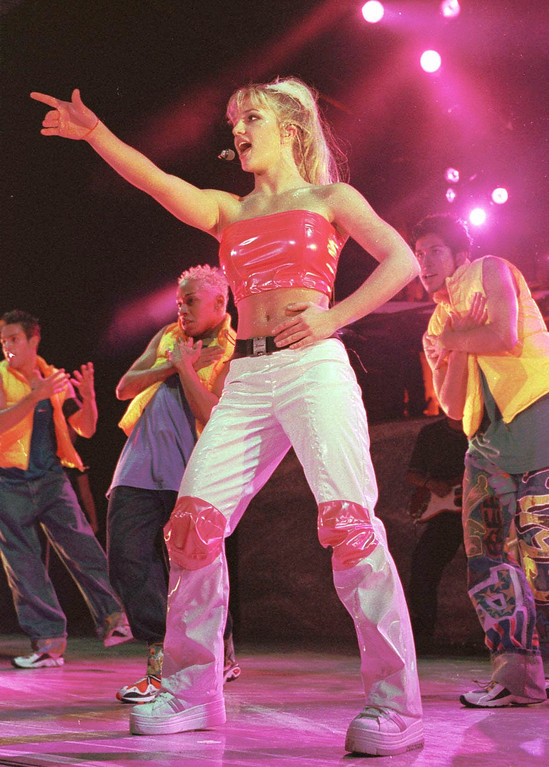". Britney Spears kicks off her ""Baby One More Time\"" tour at the Pompano Beach Amphitheater Monday, June 28, 1999, in Pompano Beach, Fla. Spears, from Kentwood, La., will tour through mid September. (AP Photo/Terry Renna)"