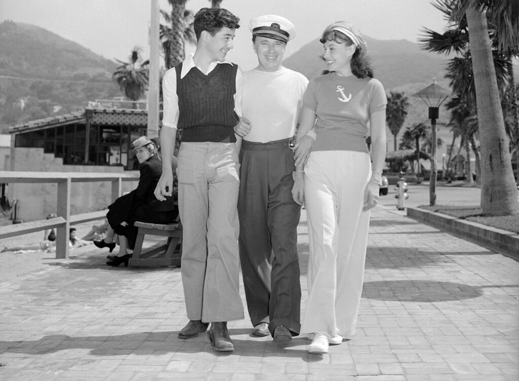 . The work of directing, writing and acting in his latest picture over, Charlie Chaplin, center, relaxes at Santa Catalina Island on April 22, 1940 where he is with Paulette Goddard and his son, Charlie, Jr. They are living aboard Paulette�s yacht, the Panacea, anchored in Avalon Bay. (AP Photo)