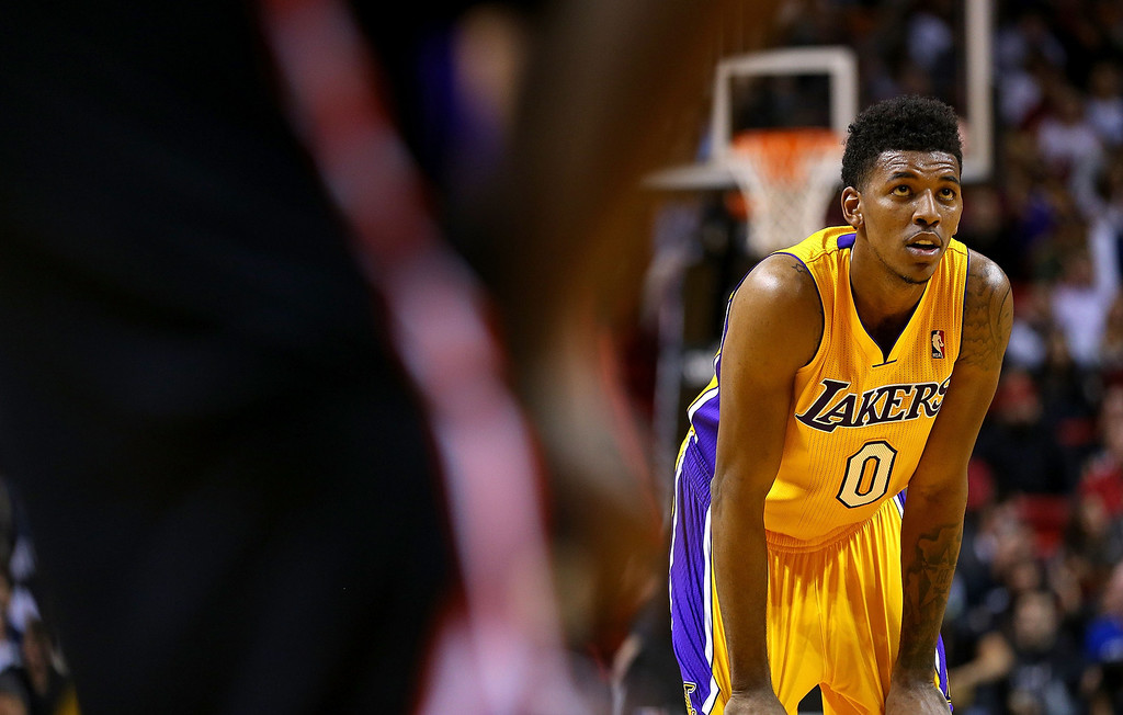 . Nick Young #0 of the Los Angeles Lakers looks on during a game against the Miami Heat at American Airlines Arena on January 23, 2014 in Miami, Florida.  (Photo by Mike Ehrmann/Getty Images)