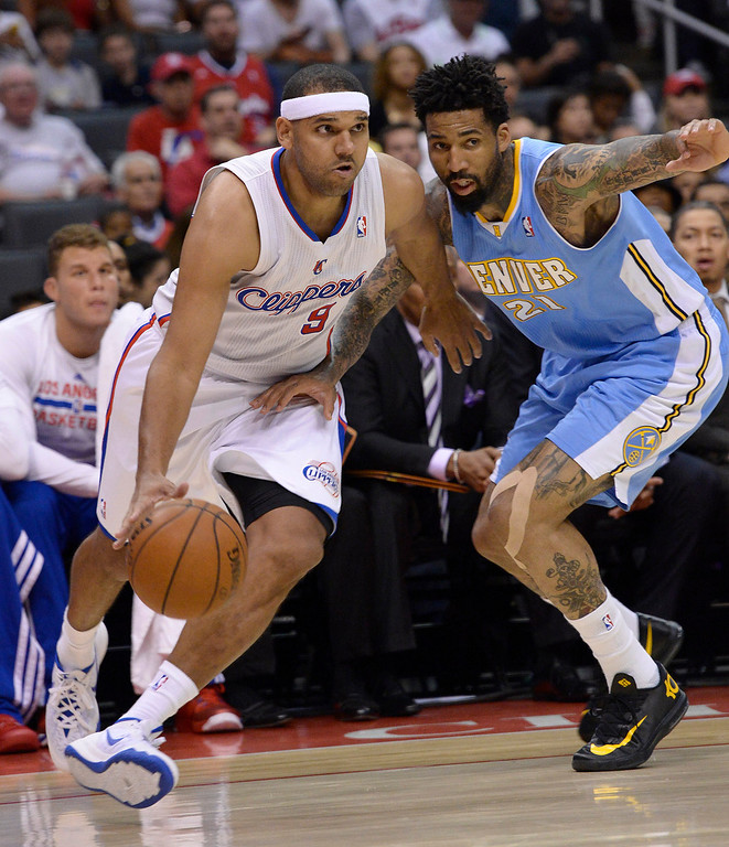 . Clippers#9 Jared Dudley drives around Nuggets #21 Wilson Chandler in the first half. The Los Angeles Clippers took on the Denver Nuggets in a regular season NBA game. Los Angeles, CA. 4/15/2014(Photo by John McCoy / Los Angeles Daily News)