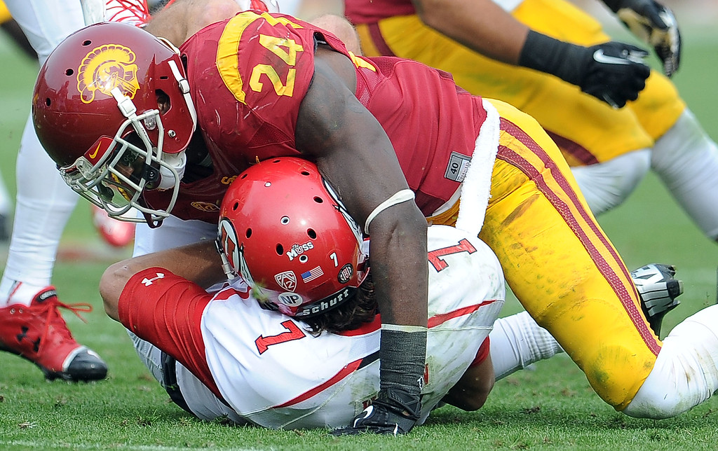 . Southern California safety Demetrius Wright (24) sacks Utah quarterback Travis Wilson (7) during the second half of an NCAA college football game in the Los Angeles Memorial Coliseum in Los Angeles, on Saturday, Oct. 26, 2013. Southern California won 19-3.   (Photo by Keith Birmingham/Pasadena Star-News)