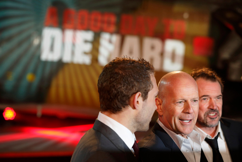 . Australian actor Jai Courtney (L), US actor Bruce Willis (C) and German actor Sebastian Koch (R) pose for photographers while arriving for the UK premiere of \'A Good Day To Die Hard\', the fifth film in the Die Hard franchise, in central London on February 7, 2013.    (JUSTIN TALLIS/AFP/Getty Images)  (Movie released on January 31, 2013)
