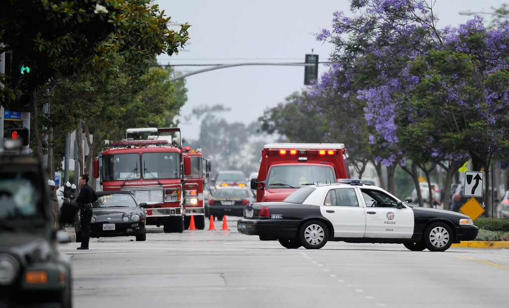 . SANTA MONICA, CA - JUNE 07:  An ambulance arrives on scene after multiple shootings were reported on the campus of Santa Monica College June 7, 2013 in Santa Monica, California.  According to reports, at least one person has died, four people hospitalized, and a suspect was taken into custody. (Photo by Kevork Djansezian/Getty Images)