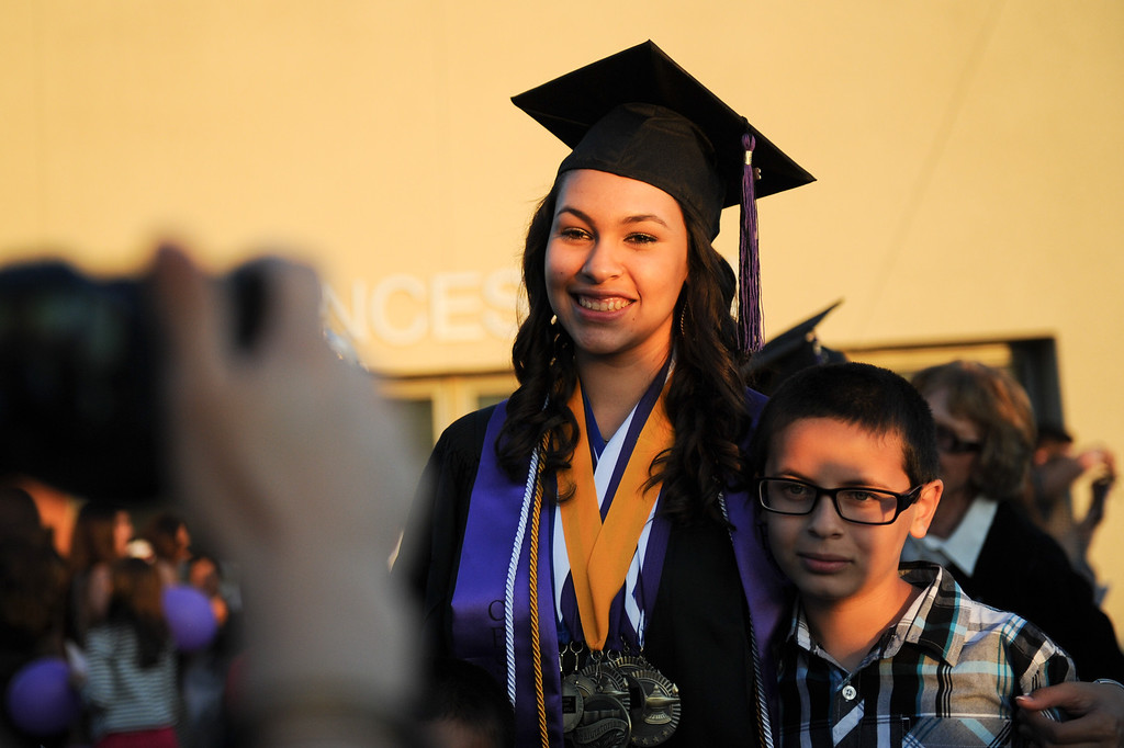 . A student takes pictures following graduation at the Cesar Chavez Learning Academies Social Justice Humanitas Academy in San Fernando, Wednesday, June 5, 2013. (Michael Owen Baker/Staff Photographer)