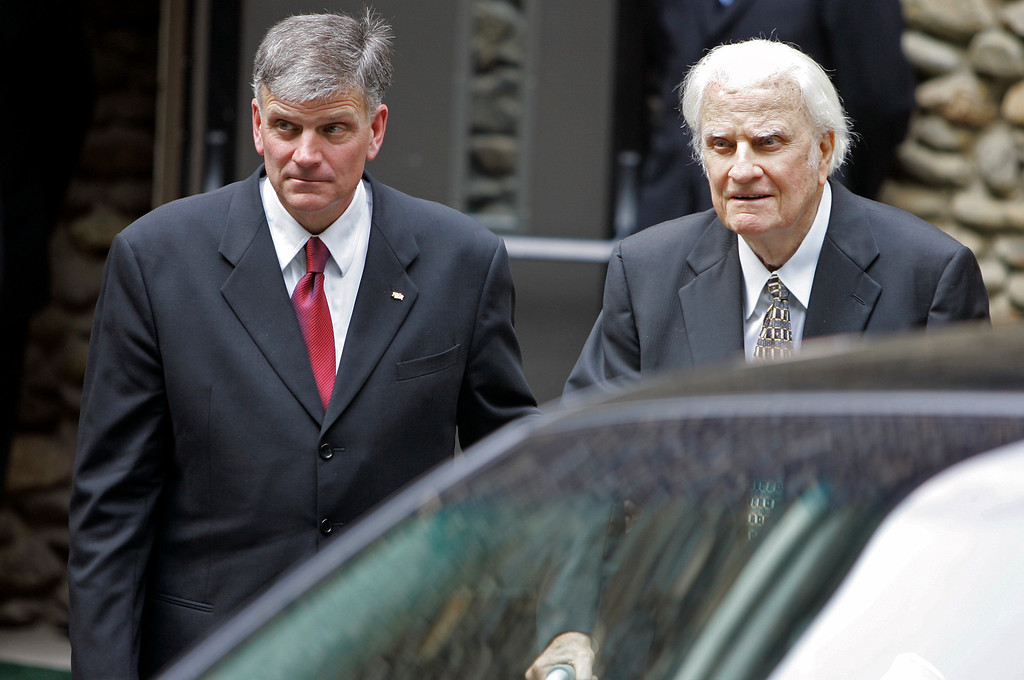 . Billy Graham, right, and his son Franklin Graham, left, leave after a memorial service for Billy Graham\'s wife, Ruth Graham, in Montreat, N.C., Saturday, June 16, 2007.  (AP Photo/Chuck Burton)