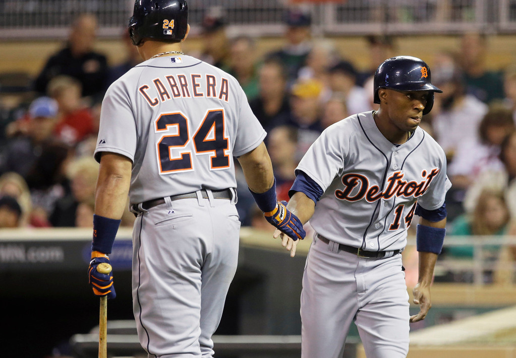 . Detroit Tigers\' Austin Jackson, right, slaps hands with Miguel Cabrera after Jackson scored on a Torii Hunter single during the first inning of a baseball game, Wednesday, Sept. 25, 2013, in Minneapolis. (AP Photo/Jim Mone)