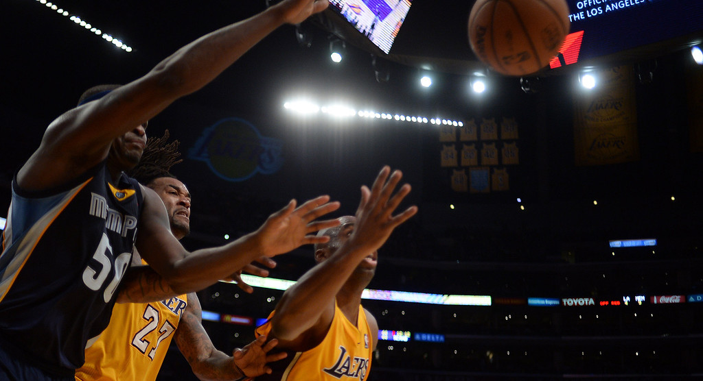 . Lakers� Jordan Hill #27 and Jodie Meeks #20 battle with the Grizzlies� Zach Randolph #50 for a loose ball during their game at the Staples Center in Los Angeles Friday, November 15, 2013. (Photo by Hans Gutknecht/Los Angeles Daily News)