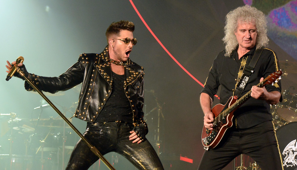 . Adam Lambert performs with Brian May of Queen at The Forum in Inglewood, Calif., on Thursday, July 3, 2014. 