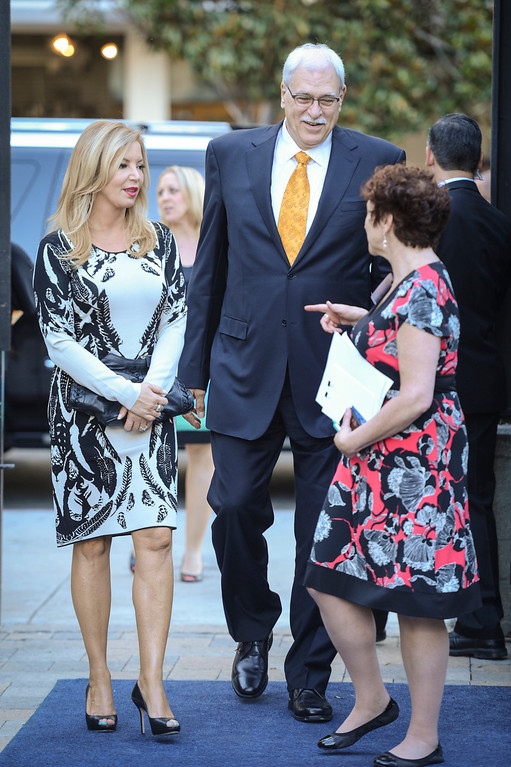 . Jeanie Buss and Phil Jackson arrive at a Time Warner event to honor the late Jerry Buss in Los Angeles.  Photo by David Crane/Los Angeles Daily News