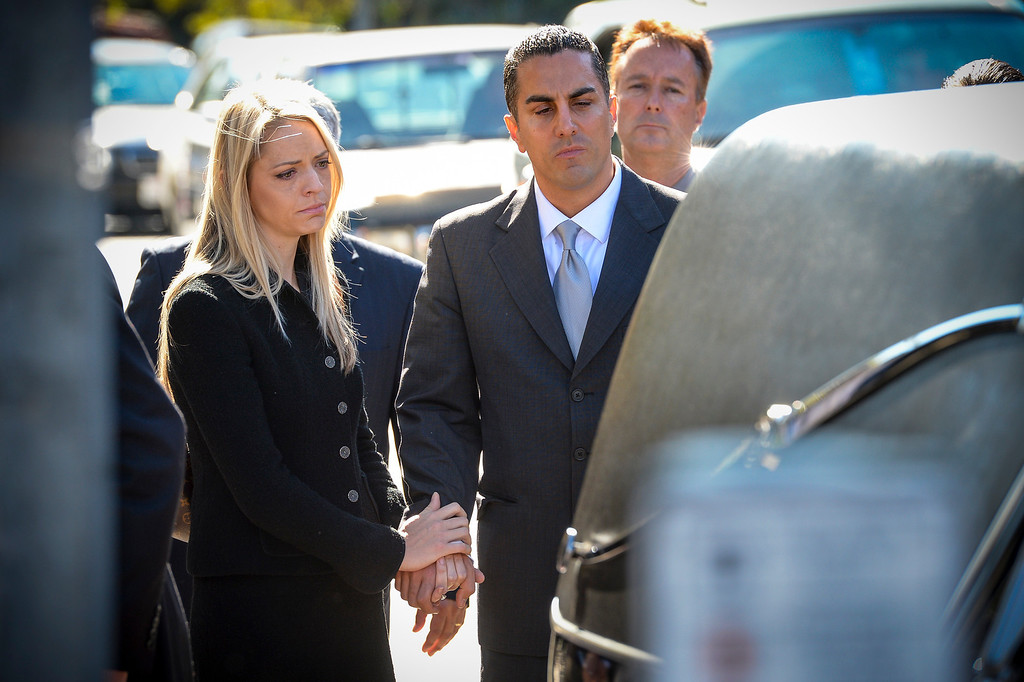 . California Assemblyman Mike Gatto and his wife Danielle at the funeral for his father, Jospeh Gatto at Our Mother of Good Counsel Catholic church on Monday November 25, 2013.  Joseph Gatto was found dead in his Silver Lake home on November 13th.    ( Photo by David Crane/Los Angeles Daily News )