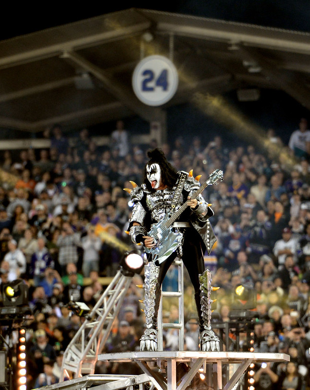 . Gene Simmons of KISS performs with the backdrop of Los Angeles Dodgers and hall of fame manger Walter Alston retired number (24) prior to the inaugural NHL Stadium Series game between the Anaheim Ducks and the Los Angeles Kings at Dodger Stadium in Los Angeles on Saturday, Jan. 25, 2014. (Keith Birmingham Pasadena Star-News)