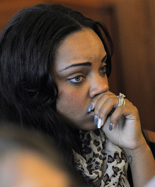 . Shayanna Jenkins, fiancee of former New England Patriots football player Aaron Hernandez, listens in the courtroom during a bail hearing for Hernandez in Fall River Superior Court Thursday, June 27, 2013, in Fall River, Mass. Hernandez, charged with murdering Odin Lloyd, a 27-year-old semi-pro football player, was denied bail. (AP Photo/Boston Herald, Ted Fitzgerald, Pool)