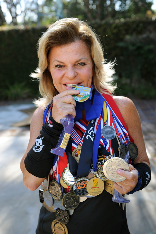 . Shannon Farar-Griefer holds medals from her previous races. Farar-Griefer who has multiple sclerosis will be running 135 miles from Upper Las Virgenes Canyon Open Space Preserve to Barstow over the course of three days in support of research for MS.  (Photo by Michael Owen Baker/L.A. Daily News)
