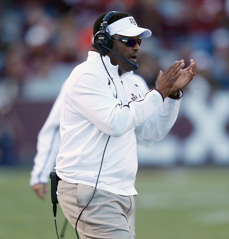 . Texas A&M head coach Kevin Sumlin encourages his team in the fourth quarter against Auburn during an NCAA college football game Saturday, Oct. 19, 2013, in College Station, Texas. Auburn won 45-41. (AP Photo/Bob Levey)