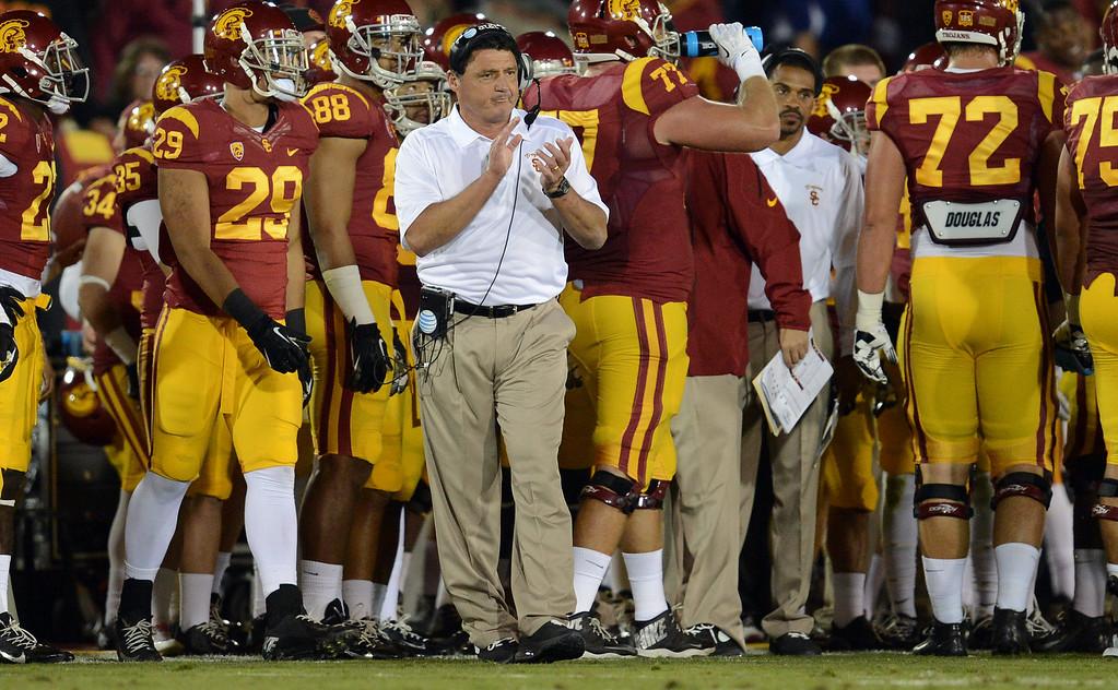 . USC 38, ARIZONA 31<br /> Oct. 10, 2013; Los Angeles Memorial Coliseum The resurgent Trojans made interim head coach Ed Orgeron a winner in his first game as Cody Kessler and Nelson Agholor connected on seven passes for 161 yards and a touchdown and USC won its first Pac-12 game. Playing without star receiver Marqise Lee, Kessler threw for 297 yards and two touchdowns and no interceptions. USC (4-2, 1-2) fought off a second-half rally by Arizona (3-2, 0-2), which totaled 528 yards of offense.   (Photo by Hans Gutknecht/Los Angeles Daily News)