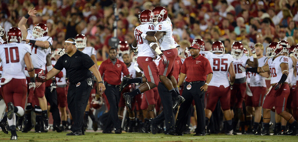 . Washington State players celebrate during their game against USC at the Los Angeles Memorial Coliseum  Saturday, September 7, 2013. Washington State beat USC10-7. (Photo by Hans Gutknecht/Los Angeles Daily News)
