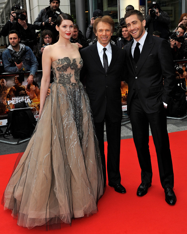 . British actress Gemma Arterton, left, U.S. producer Jerry Bruckheimer, center, and U.S. actor Jake Gyllenhaal arrive at the world premiere of Prince of Persia: Sands of Time, at a cinema in Westfield in west London, Sunday, May 9, 2010. (AP Photo/Jorge Herrera)
