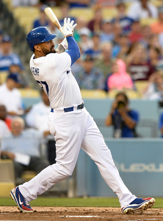 . Matt Kemp hits a single home run in the 2nd inning. The Dodgers played host to the Atlanta Braves in a game played at Dodger Stadium in Los Angeles, CA. 7/30/2014(Photo by John McCoy Daily News)