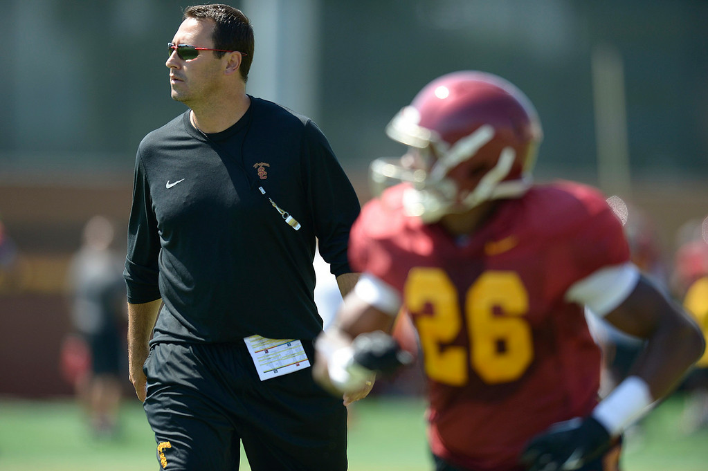 . Coach Steve Sarkisian keeps an eye on the action. Football practice is in full swing on the Howard Jones Field at USC. Los Angeles, CA. 8/6/2014(Photo by John McCoy Daily News)