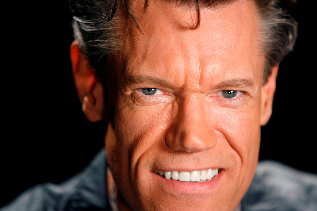 ". Musician Randy Travis poses for a picture in New York, Thursday, July 17, 2008.  Travis just released a new album, ""Around the Bend\"".  (AP Photo/Seth Wenig)"
