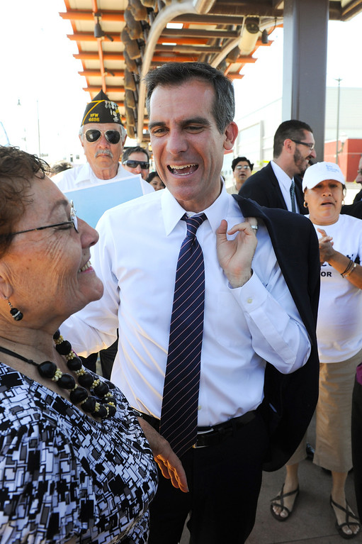 . Mayoral candidate Eric Garcetti is greeted by supporters on a Gold Line metro stop in East Los Angeles during his Whistle Stop Tour of LA, Monday, May 20, 2013. Garcetti used the Expo, Gold and Red metro lines to greet voters in Los Angeles. (Michael Owen Baker/Staff Photographer)