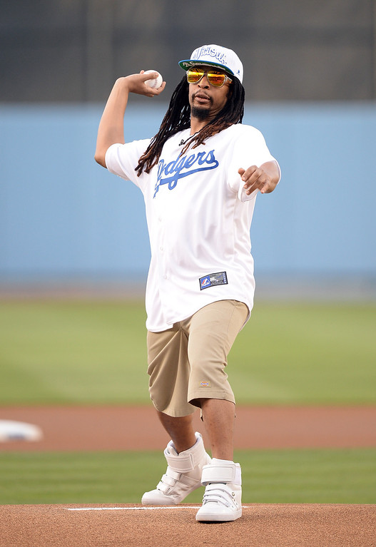. Rapper Lil Jon throws a ceremonial first pitch before the game between the St. Louis Cardinals and the Los Angeles Dodgers at Dodger Stadium on May 24, 2013 in Los Angeles, California.  (Photo by Harry How/Getty Images)