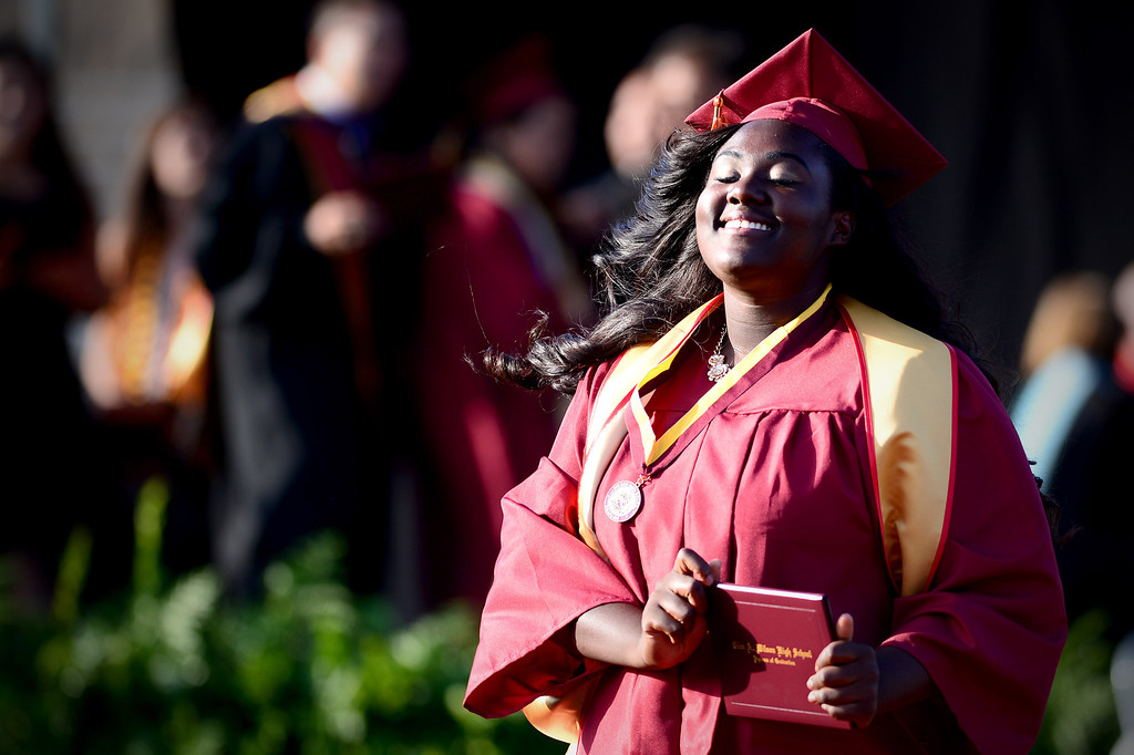 . Patricia Monyei, a district scholar, celebrates after  receiving her diploma during Wilson High School\'s forty-seventh commencement ceremony Tuesday evening, May 20, 2014 at the Hacienda Heights school. (Photo by Sarah Reingewirtz/Pasadena Star-News)
