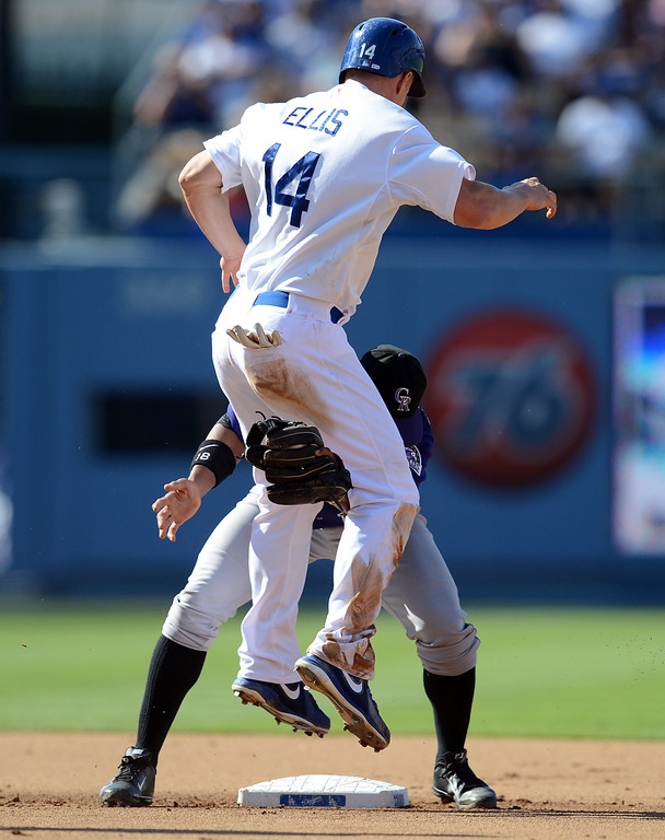 . The Dodgers\' Mark Ellis #14 gets tangled up with the Rockies Jonathan Herrera #18 on a double play in the 3rd inning during their game at Dodger Stadium in Los Angeles Saturday, July 13, 2013. The Dodgers beat the Rockies 1-0.(Hans Gutknecht/Los Angeles Daily News)