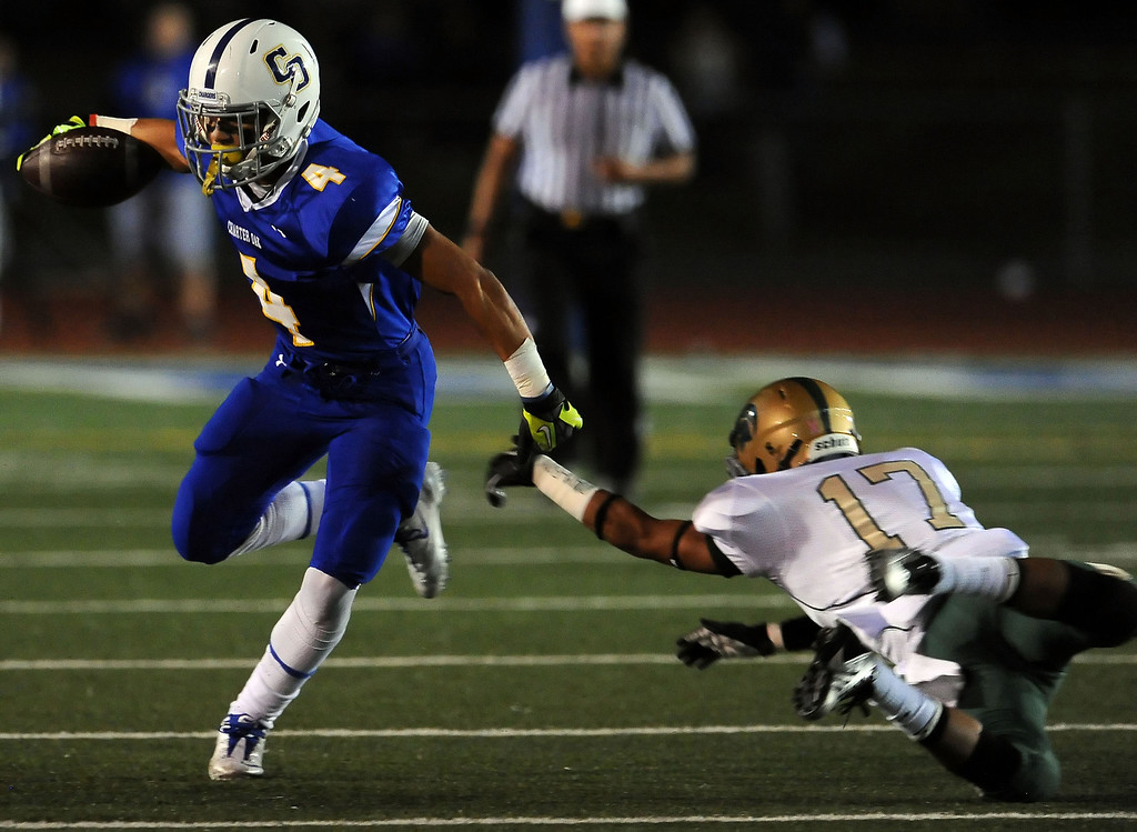 . Charter Oak\'s Donavin Washington (4) runs past Damien\'s Aaron Gonzales (17) for a first down in the first half of a prep football game at Charter Oak High School in Covina, Calif., Friday, Oct. 11, 2013.    (Keith Birmingham Pasadena Star-News)