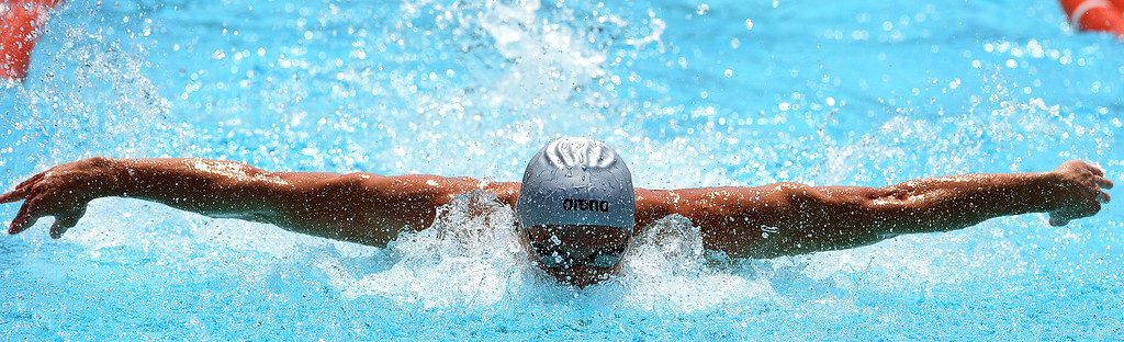 . Los Osos\'s Kyle Coan wins the 100 yard butterfly during the Division 2 CIF Southern Section Swimming Championships in the Riverside Aquatics Complex at Riverside City College in Riverside, Calif., on Saturday, May 17, 2014.