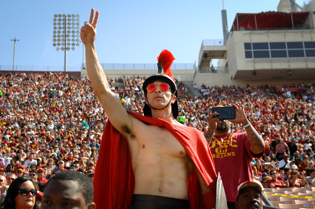 """. Joe Stein gets into character \""""Trojan Joe\"""" at the spring game, Saturday, April 19, 2014, at the Coliseum. (Photo by Michael Owen Baker/L.A. Daily News)"""