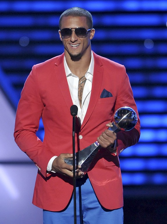 . San Francisco 49ers\' Colin Kaepernick accepts the award for best breakthrough athlete at the ESPY Awards on Wednesday, July 17, 2013, at Nokia Theater in Los Angeles. (Photo by John Shearer/Invision/AP)