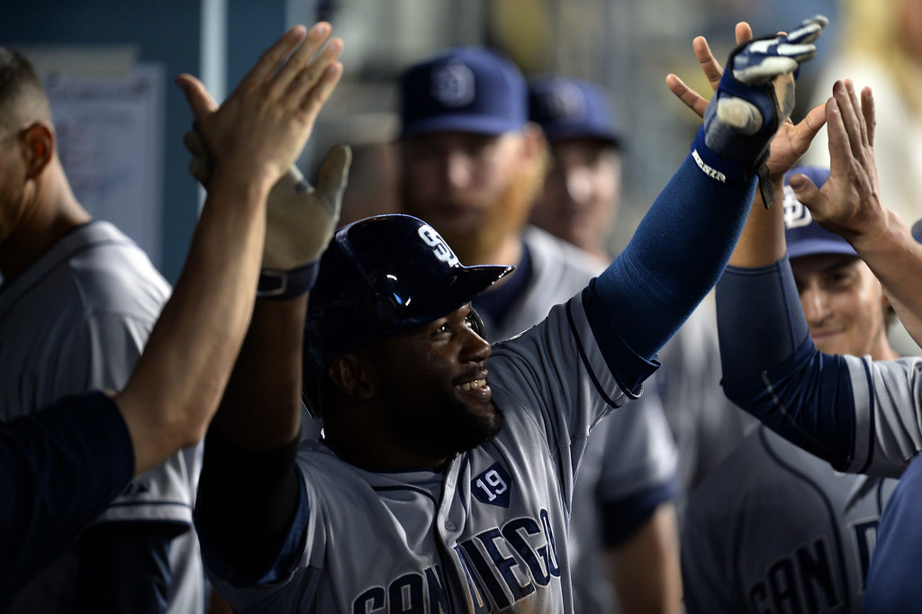 . The Padres� Abraham Almonte #16 enters the dugout after scoring in the seventh inning during their game against the Dodgers at Dodger Stadium Thursday, August 21, 2014. (Photo by Hans Gutknecht/Los Angeles Daily News)