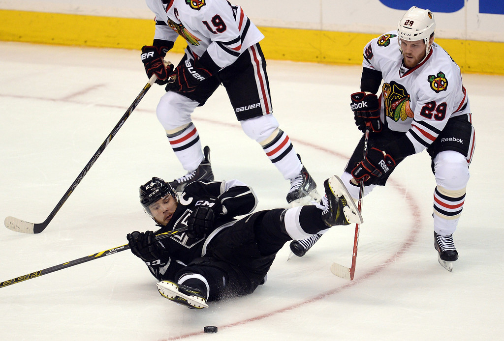 . The Kings� Dustin Brown #23 falls to the ice as Blackhawks� Bryan Bickell #29 and Jonathan Toews #19 close in during Game 6 of the Western Conference finals first period action at the Staples Center on Friday, May 30, 2014. (Photo by Hans Gutknecht/Los Angeles Daily News)