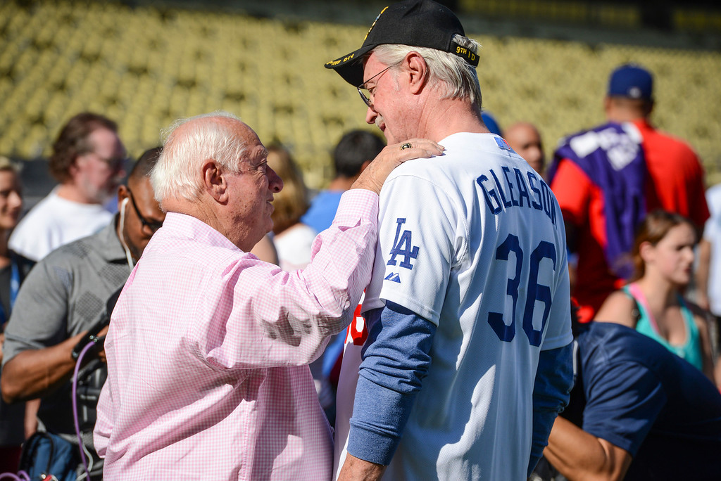 . Dodgers\' Tommy Lasorda speaks to former Dodger Roy Gleason veterans during Veterans Day at Dodger Stadium Monday, November 11, 2013.  The dodgers hosted 100 active duty and retired military to Dodger Stadium to take part in batting practice, enjoy and Dodger lunch and tour the facilities.    ( Photo by David Crane/Los Angeles Daily News )