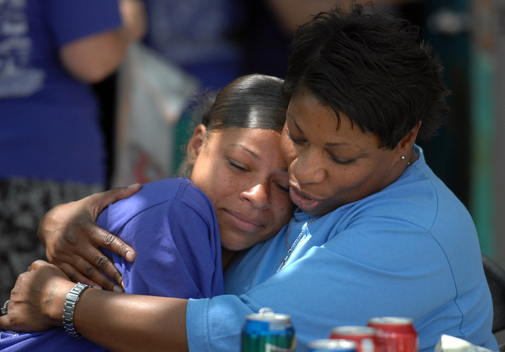 . 5/4/13 - Veronique Crenshaw holds her daughter Kristine Crenshaw, 17,  during a visit at the California Institution for Women. The mothers and children were united by the non-profit organization entitled Get On The Bus which provides an annual event of free transportation for the children and their caregivers to the prison. The visit becomes more of an event, with snacks, lunch, arts, crafts, photos, keepsakes and plenty of hugs and kisses. The program began in 2000 with one bus one prison and 17 kids. Today children are able to visit their mothers and fathers with 60 buses, seven prisons and more than a thousand kids. Photo by Brittany Murray / Staff Photographer