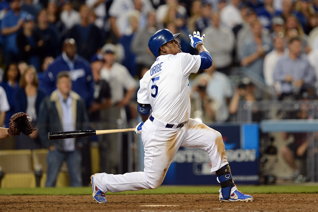 . The Dodgers\'  Juan Uribe watches the ball head for the fence on his bottom of the 8th 2 run homer against the Atlanta Braves during game 4 of the NLDS at Dodger Stadium Monday, October 7, 2013. The Dodgers beat the Braves 4-3.(Photo by Hans Gutknecht/Los Angeles Daily News)