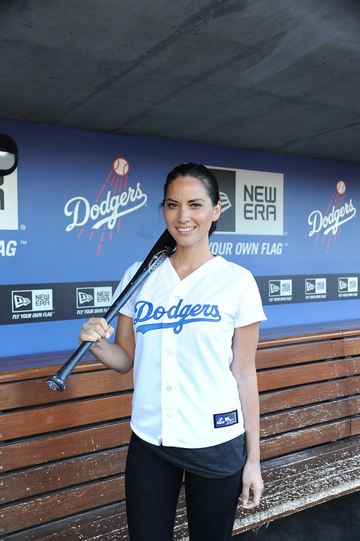 . In this handout photo provided by the Los Angeles Dodgers, actress Olivia Munn visits Dodger Stadium to throw the first pitch before the Los Angeles Dodgers vs Arinzona Diamondbacks June 10, 2013 in Los Angeles, California.  Munn watched batting practice and met Dodger players including fellow Oklahoman Matt Kemp, Brandon League and Hanley Ramirez. She joined the in-stadium pre-game live show prior to her first pitch and also hung out in the Dodgers\' dugout.  (Photo by Jon SooHoo/Los Angeles Dodgers via Getty Images)