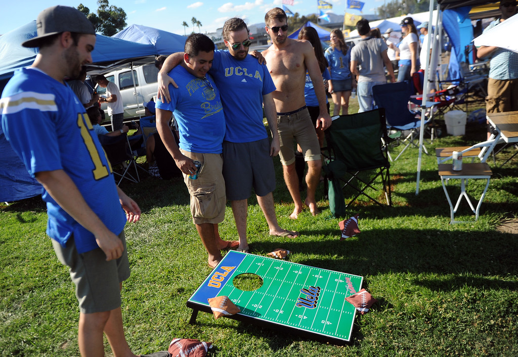 . UCLA fans play a toss the bean bag game prior to a college football game between Nevada and UCLA in the Rose Bowl on Saturday, Aug. 31, 2013 in Pasadena, Calif.    (Keith Birmingham Pasadena Star-News)