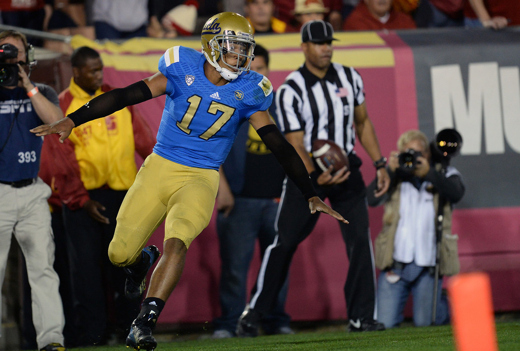 . UCLA�s Brett Hundley #17 reacts after scoring a second half touchdown during their game at the Los Angeles Memorial Coliseum Saturday, November 30, 2013.  UCLA beat USC 35-14. (Photo by Hans Gutknecht/Los Angeles Daily News)