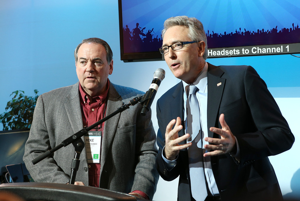 . ANAHEIM, CA - JANUARY 22:  Former Arkansas Governer Mike Huckabee and NAMM President and CEO Joe Lamond attend the 2014 National Association of Music Merchants show media preview day at the Anaheim Convention Center on January 22, 2014 in Anaheim, California.  (Photo by Jesse Grant/Getty Images for NAMM)