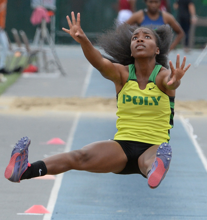 . Long Beach Poly\'s Onyx Gaston competes in the division 1 long jump during the CIF Southern Section track and final Championships at Cerritos College in Norwalk, Calif., on Saturday, May 24, 2014. 