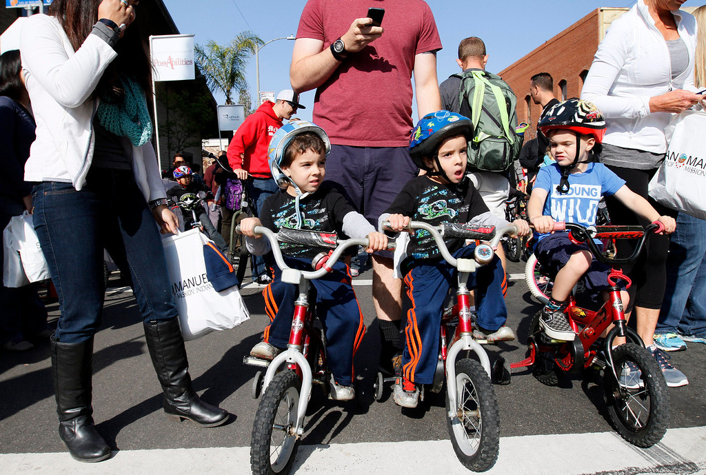 . Four-year-old twin brothers Alex, left, and Daniel Aguiar, of Redlands, wait at the starting line during the public race portion of the Redlands Bicycle Classic on Saturday, April 5, 2014 in Redlands, Ca. (Photo by Micah Escamilla for the Redlands Daily Facts)