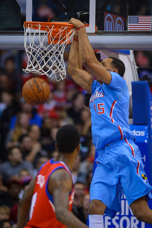 . Clippers� Ryan Hollins slams in two points against the 76ers at Staples Center Sunday.  The Clippers defeated the 76ers 124-78.  ( Photo by David Crane/Los Angeles Daily News )