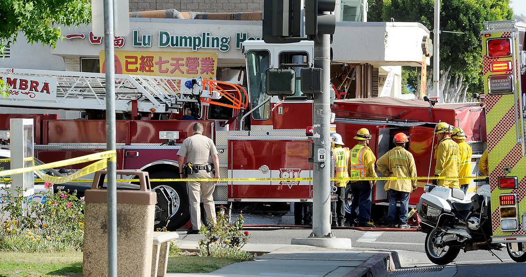 . An Alhambra Fire ladder truck and Monterey Park truck collided in the intersection of Garfield Avenue and Emerson Avenue Wednesday April 16 2014. The Monterey Park Fire engine drove into a Chinese restaurant. One civilian is in critical condition,  one firefighter with moderate injuries, and five firefighters with minor injuries, and  eight civilians with minor injuries.(Photo by Walt Mancini/Pasadena Star-News)