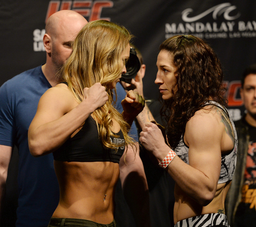 . Ronda Rousey and Sara McMann face off during weigh ins for UFC 170 at the Mandalay Bay Events Center in Las Vegas Friday, February 21, 2014. (Photo by Hans Gutknecht/Los Angeles Daily News)
