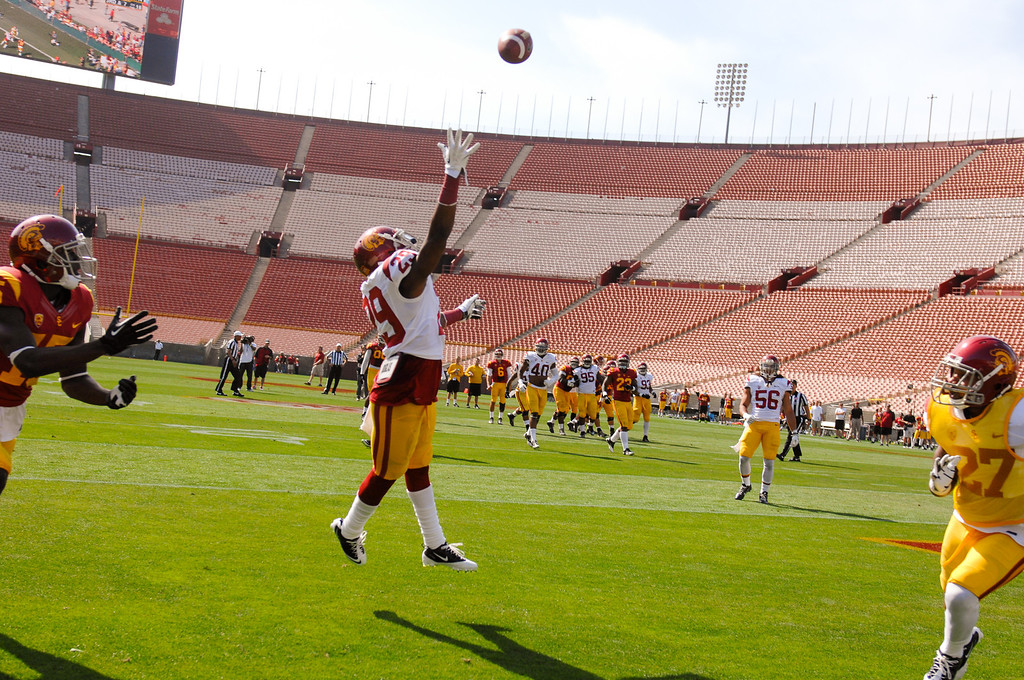 . USC DB Chris Hawkins leaps to break up a pass in the endzone during the spring game, Saturday, April 19, 2014, at the Coliseum. (Photo by Michael Owen Baker/L.A. Daily News)
